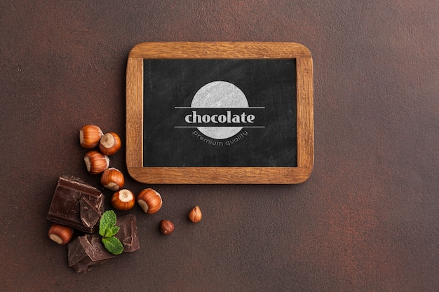 Delicious chocolate with blackboard mock-up on brown background