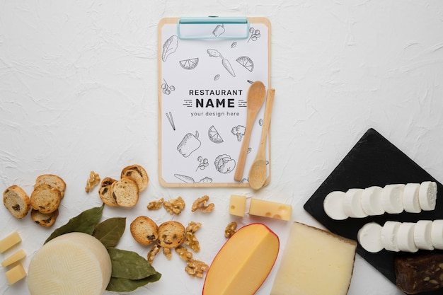 Delicious food composition with clipboard mock-up