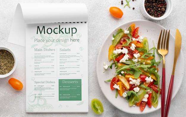 Delicious healthy salad mock-up flat lay