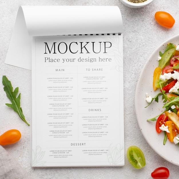 Delicious healthy salad mock-up above view