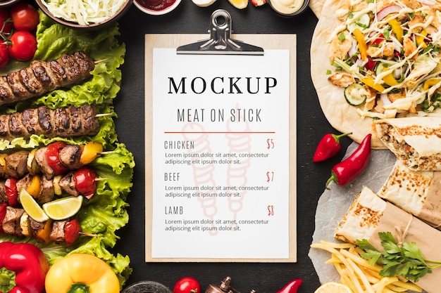 Delicious meat skewers mock-up and clipboard