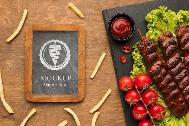 Delicious meat skewers mock-up and fries