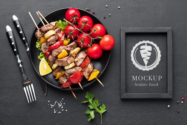 Delicious meat skewers mock-up and tomatoes
