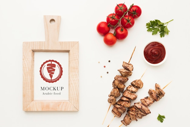 Delicious meat skewers mock-up top view