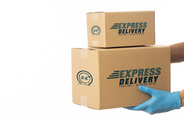 Delivery man hand holding cardboard boxes