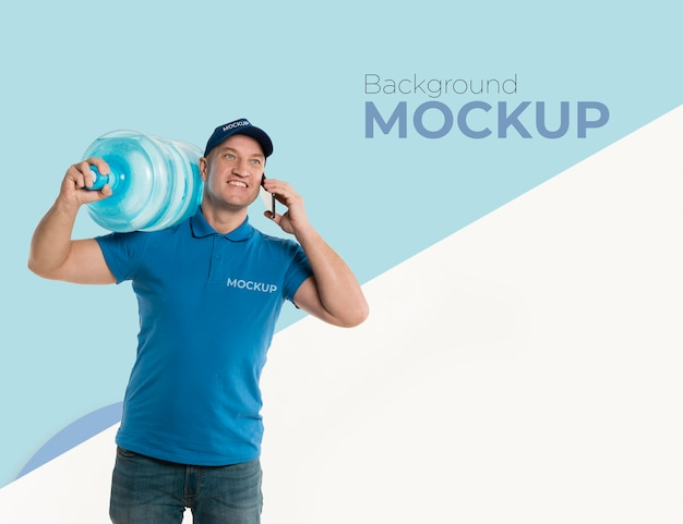 Delivery man holding a big bottle of water with background mock-up