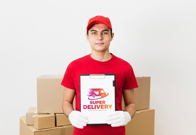 Delivery man holding clipboard near parcels mock-up