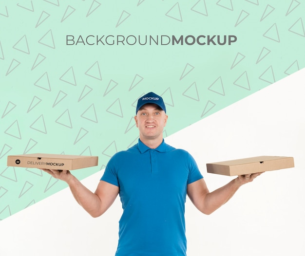 Delivery man holding pizza boxes with background mock-up