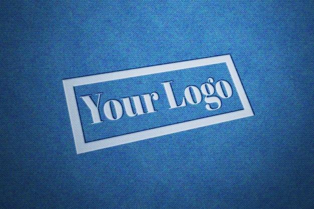 Макет текстурированного логотипа из джинсовой ткани