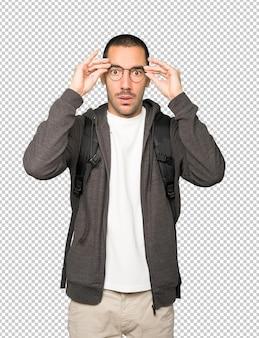 Depressed student posing against background