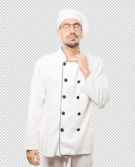Depressed young chef doing a gesture of stress