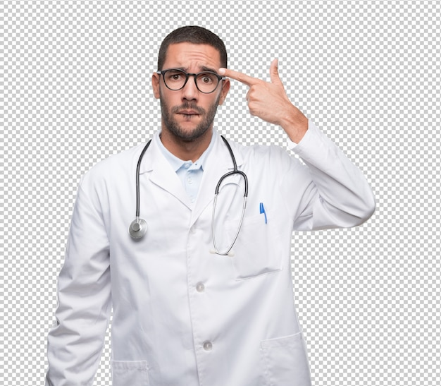 Depressed young doctor doing a suicide gesture