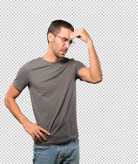 Depressed young man posing