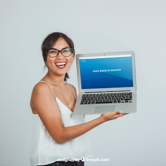 Design of mock up with happy young woman and laptop's screen
