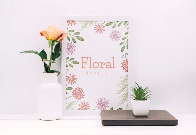 Desk composition with flower decor and frame mockup