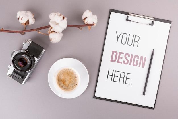 Desk concept with photo camera