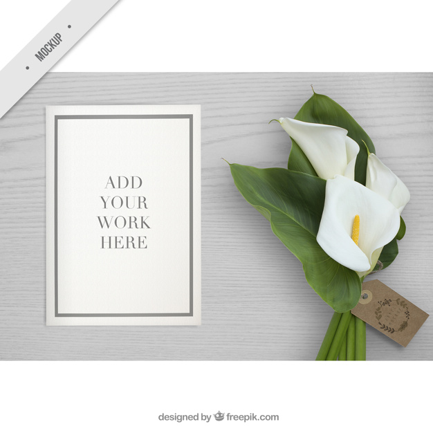 Desktop with a paper mockup and flower for your work