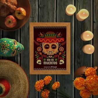 Dia de muertos skulls with sombrero on wooden background top view