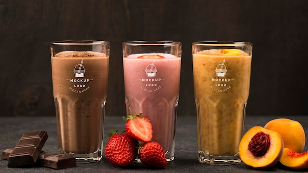 Different fruit smoothies in glasses front view