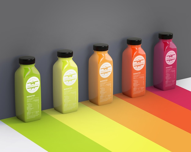 Different smoothies next to gray wall mock-up