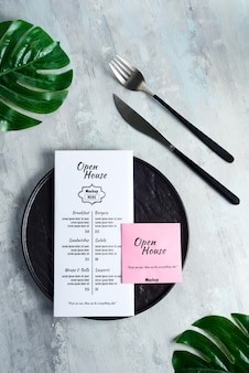 Dinner set served brochures with fork and knife.