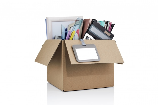 Dismissal. box with office supplies. cardboard box full of office stuff.