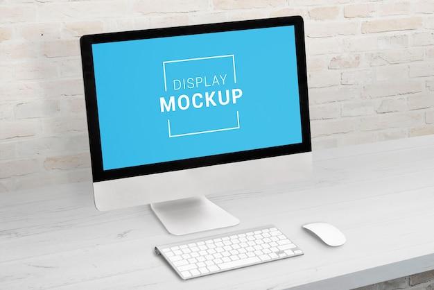 Display mockup on office desk.