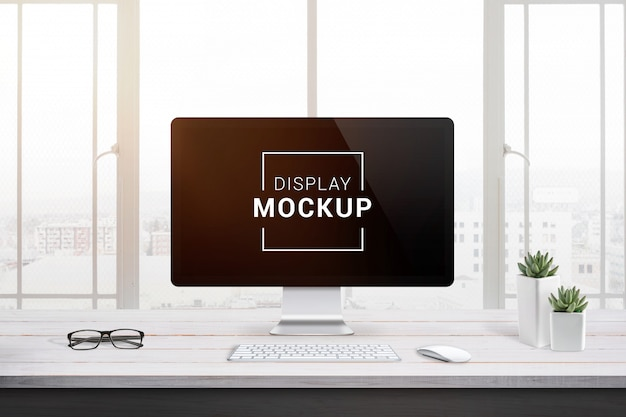 Display mockup on office desk. Premium Psd
