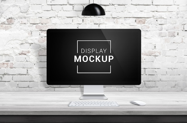 Display mockup on wooden desk with brick wall