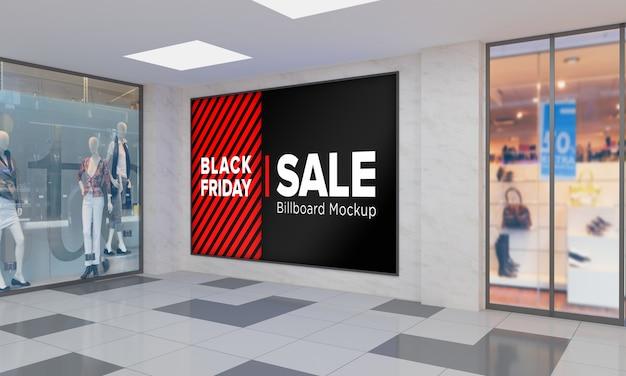 블랙 프라이데이 판매 배너가있는 쇼핑 센터의 벽 모형에 사인 보드 표시