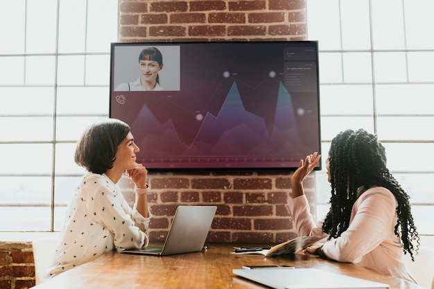 Diverse colleagues having a conference with a tv screen mockup