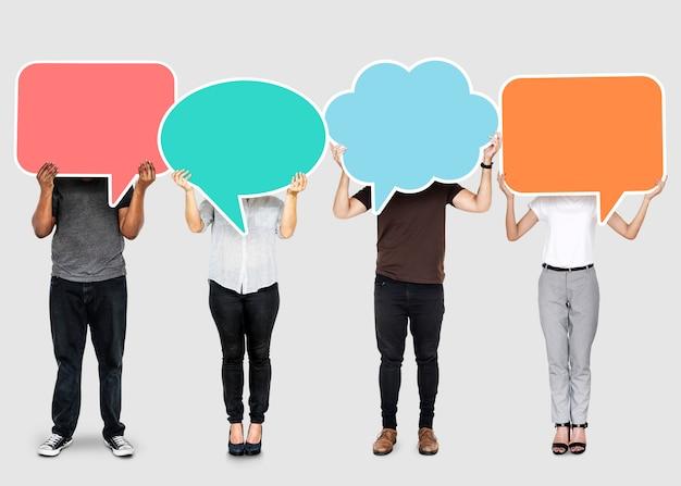 Diverse people showing speech bubble symbols