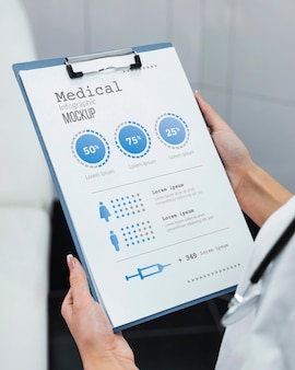 Doctor holding clipboard mock-up