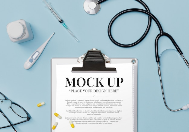 Doctor medical equipment blue table with stethoscope, medical documents, thermometer, syringe and pills with copy space mockup template