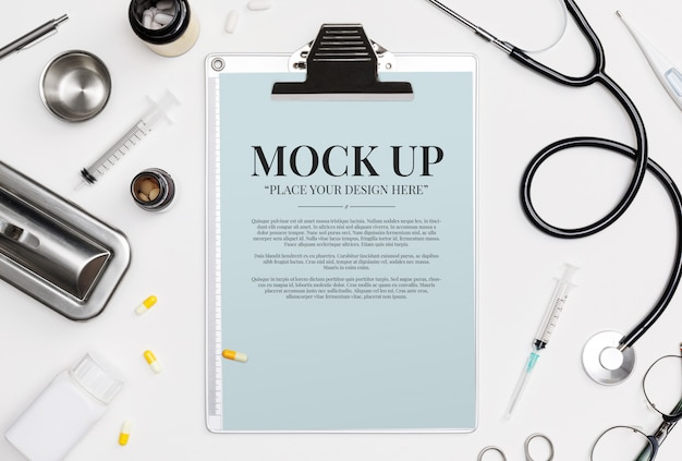 Doctor medical equipment white backgroud with stethoscope, medical documents, thermometer, syringe and pills with copy space mockup template