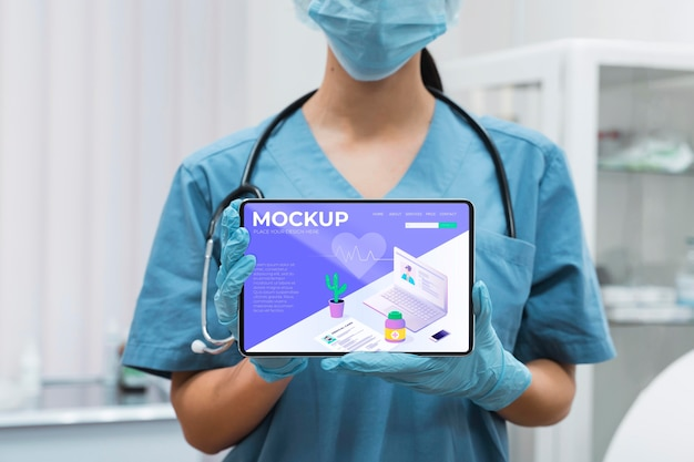 Doctor with face mask holding tablet mock-up