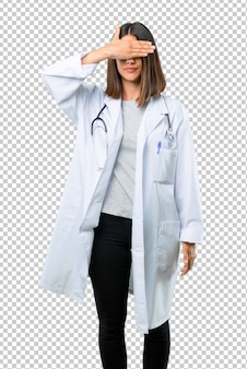 Doctor woman with stethoscope covering eyes by hands. do not want to see something