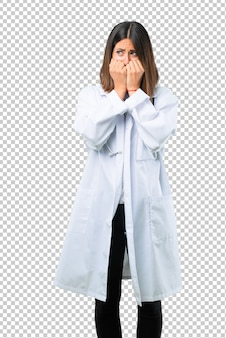Doctor woman with stethoscope is a little bit nervous and scared putting hands to mouth