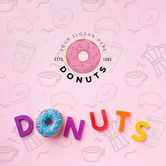 Donut and letters arrangement with mock-up