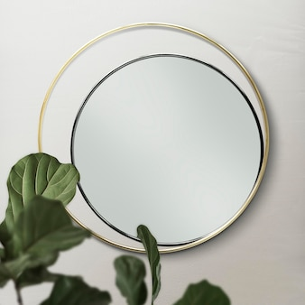 Double mirror on a beige wall with fiddle-leaf fig leaves mockup