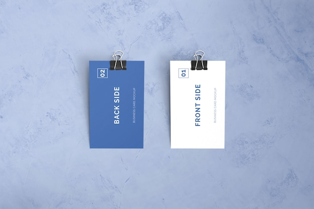 Double sided business card laying on marble with paper clip mockup