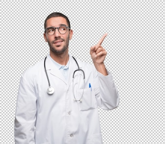 Doubtful young doctor pointing up
