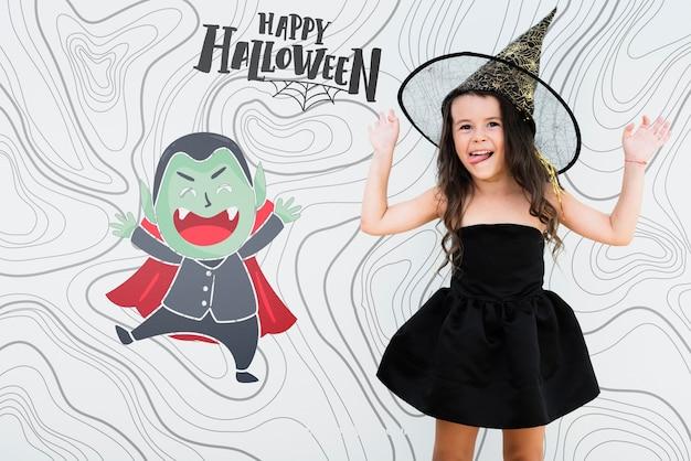 ハロウィーンの吸血鬼と魔女にdressした少女をトリックオアトリート