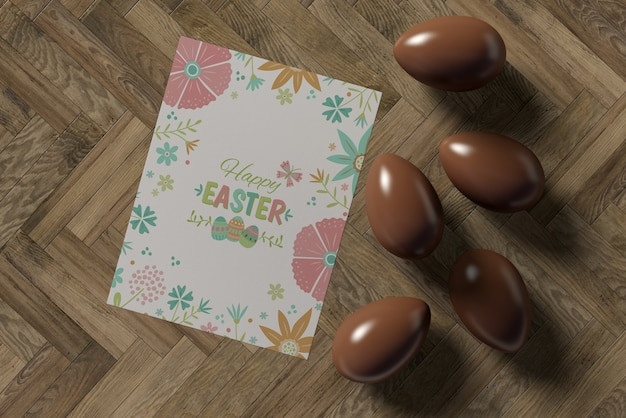 Carta di pasqua e uova di cioccolato