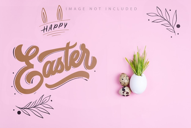 Easter grass growing in egg shell and quail eggs on a pink mockup surface. eco concept