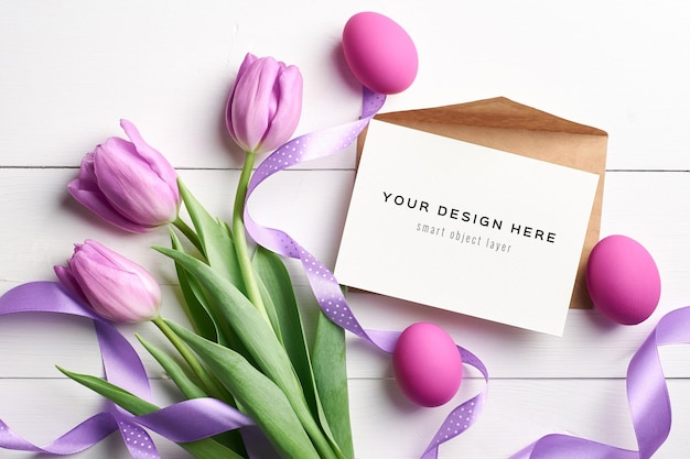 Easter holiday greeting card mockup with colored eggs, ribbons and violet tulips
