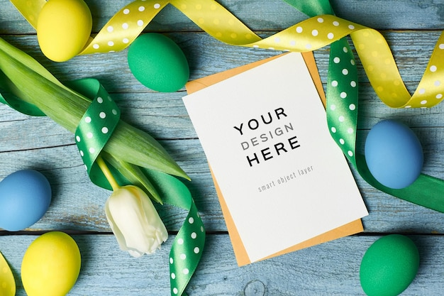 Easter holiday greeting card mockup with colored eggs and ribbons