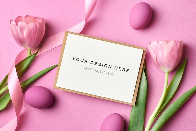 Easter holiday greeting card mockup with colored eggs and tulips on pink