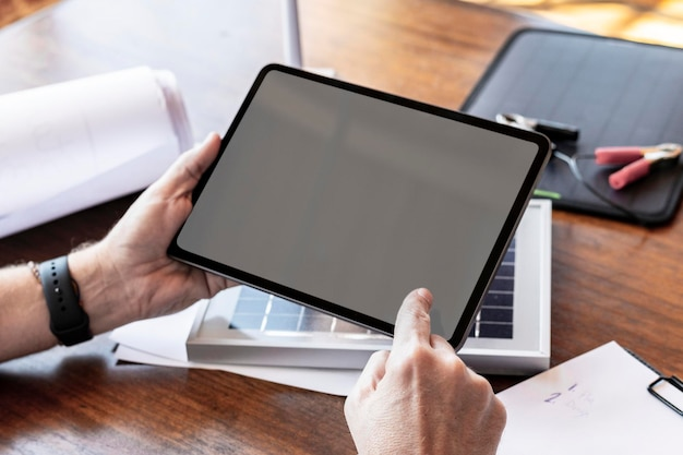 Eco-friendly engineer using a digital tablet mockup