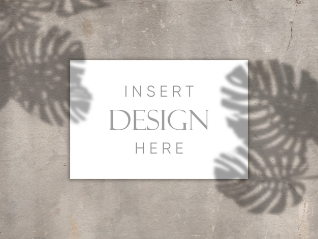 Editable mock up design with blank card on concrete texture with shadow overlay background